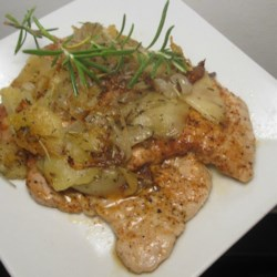 Autumn Apple Onion Pork Chops Recipe - Seasoned pork chops are served with a savory apple and onion topping for the perfect warm and comforting meal on autumn evenings.