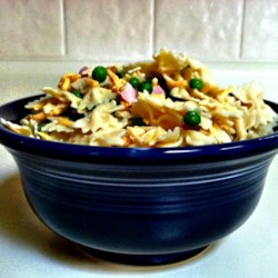 Ham and Cheese Pasta Salad Recipe - This pasta salad is a perfect vehicle for leftover ham. Cheddar cheese, peas, celery, and pimento give this pasta salad a nice color and flavorful dimension.