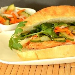Banh Mi Recipe - This version of the popular Vietnamese bahn mi sandwich has sweet and tangy pickled vegetables and broiled chicken breast, served on a toasted French baguette.