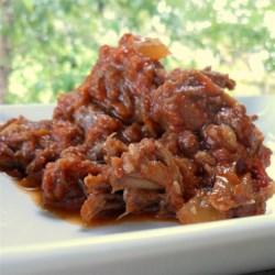 Barbeque Shredded Beef Recipe - Make shredded barbeque-style beef in the slow cooker with some onion, tomato sauce, vinegar, dry mustard, and chili powder.
