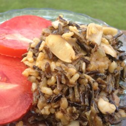Rebecca's Wild Rice Pilaf Recipe - Mushrooms, onions, and almonds transform ordinary wild rice into an elegant pilaf.  The nutty flavors perfectly compliment roasted meat or fish.