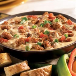 Hot Sausage Dip from Hatfield(R) Recipe - Hot Italian sausage is browned and stirred into a creamy mixture of cheese, spicy tomatoes, and chopped green onions--a perfect dip for corn tortilla chips.