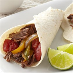 Roast Beef and Tomato Fajitas Recipe - Tender, slow-cooked shredded beef is served on warm tortillas with bell pepper strips and tomatoes.