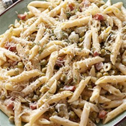 Penne with Peas and Pancetta Recipe - Hot cooked penne pasta is tossed in a creamy, cheesy sauce with sweet peas and crumbled pancetta for a quick weeknight meal.