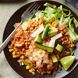 Spicy Chili-Chicken Rice Recipe - Brown rice with chopped chicken, corn with chiles, and lots of spice is baked with shredded cheese and served over shredded lettuce with chopped avocado and crunchy jicama strips.