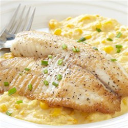 Sauteed Tilapia with Creamed Corn and Chives Recipe - The mild flavor of tilapia fillets goes perfectly with a creamy, cheesy side dish of sweet corn sprinkled with chives in this easy, quick recipe.