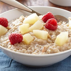 Vanilla-Pear Breakfast Oatmeal Recipe - Sweet pears and raspberries dress up this recipe for oatmeal flavored with cinnamon and vanilla for a special breakfast quick enough for any morning.