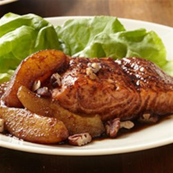 Balsamic Salmon with Pears and Pecans Recipe - Broiled salmon fillets with a fruity, tangy glaze are served with pears on crisp lettuce leaves and sprinkled with toasted pecans.