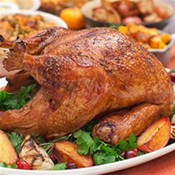 Brined and Roasted Whole Turkey Recipe - No dish has more riding on its success than the holiday turkey. Brining locks in a turkey's natural juices, so it won't dry out during the roasting process, ensuring the perfect centerpiece for a flavorful feast.