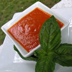 Homemade Pizza Sauce from Scratch Recipe - Fresh roma tomatoes are simmered with simple seasonings to create a tasty homemade pizza sauce. This makes a large batch for freezing.