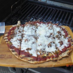 El Paso Pizza Recipe - A pizza with southwestern-style toppings gives you the best of both worlds when you can't decide between pizza and Mexican.