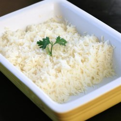 Oven Baked Rice Recipe - Bake jasmine rice in a mixture of water, salt, vinegar, and butter for a tastier side dish.