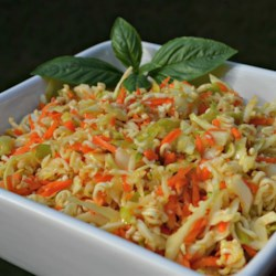 Chinese Cabbage Salad Recipe - Sesame oil, rice vinegar, shredded cabbage, and crushed ramen noodles make this beautiful salad the perfect accompaniment to your favorite Asian dishes.