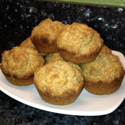V's Apple Bran Muffins Recipe - Applesauce and bran flakes cereal are the star ingredients in these delightful apple bran muffins. Easy to customize to anyone's flavor favorites!