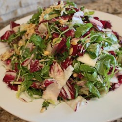 Tri-Color Chopped Salad with Pine Nuts and Parmesan Cheese Recipe - This chopped salad mixes arugula, Belgian endive and radicchio with the magical combo of pine nuts and Parmesan, tossed in a mustard and oregano vinaigrette.