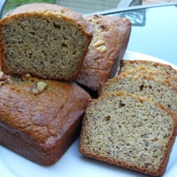 Angie's To-Die-For Banana Bread Recipe - Tender banana bread is made with sour cream and buttermilk for richness. This recipe contains no nuts. Serve it warm with butter.