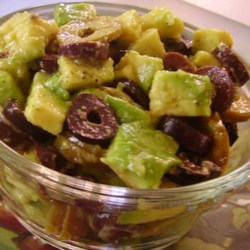 Avocado Olive Salad Recipe - Diced avocado slices are tossed with black olives in a tangy Parmesan cheese dressing.