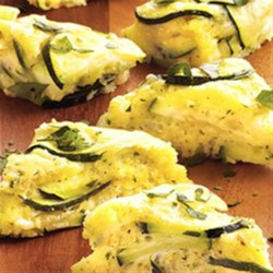 Zucchini Appetizers Recipe - Use this appetizer recipe to help use up an abundant zucchini crop. Your guests will love every zucchini and cheese bite.