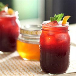 Honey-Hibiscus Orange Punch Recipe - Honey packs a naturally sweet punch in this delicious drink!