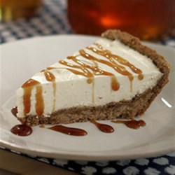 Honey-Vanilla Bean Cheesecake Recipe - A hint of honey in a graham cracker crust is the perfect way to sweeten up any cheesecake. This Honey Vanilla Bean Cheesecake will soon become your go-to dessert!