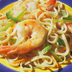 Linguini with Honey-Sauced Prawns Recipe - A quarter cup of honey is all it takes to brighten this dish. By adding a hint of sweetness, the linguini and sauce make a deliciously balanced bite.