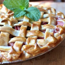 Strawberry Raisin Rhubarb Pie Recipe - Raisins add sweetness and texture to a classic strawberry-rhubarb pie with a pretty lattice crust.