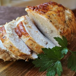 Rosemary Roasted Turkey Recipe and Video - In this method, which can be used with all types of poultry, olive oil infused with garlic and rosemary is rubbed between the skin and meat of the bird before roasting.