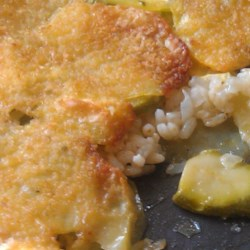 Potato, Rice and Zucchini Bake Recipe - Thinly sliced potato and zucchini are baked with fluffy rice and Parmesan cheese in this Italian-inspired dish.