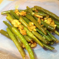 Curried Green Bean Salad Recipe - This version of a cold bean salad is made with canned green beans, garlic, ginger, and curry powder.