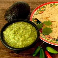 Spicy Avocado Sauce Recipe - This sauce is made of avocado, tomatillo, serrano peppers, and cilantro.
