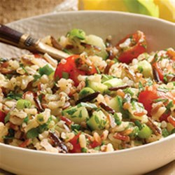 Mediterranean Tabbouleh Salad Recipe - Hearty cooked whole grains are tossed in a lemon vinaigrette, then mixed with chopped parsley, cucumber, cherry tomatoes, and mint leaves.