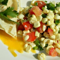 Fresh Corn Salsa with Orange and Lime Recipe - This recipe combines fresh summer corn with tomatoes, jalapenos, and cilantro, then tops them off with orange and lime juices for an extra zing of flavor.