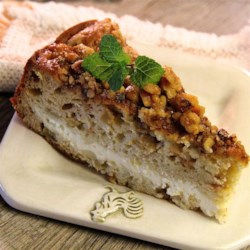 Apple Cream Cheese Coffee Cake Recipe - Chunks of apple float in this tender cake with a sweet cream cheese filling.