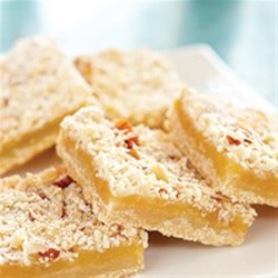 Lemon Curd Bars Recipe - Using a prepared lemon curd makes baking tangy, fruity lemon bars so easy you can whip up a batch anytime. Coconut and almonds add extra richness and texture.