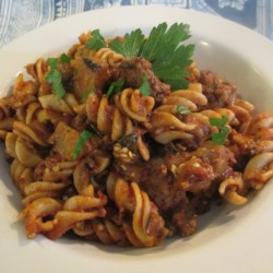 Ziti and Eggplant Recipe - An eggplant and tomato sauce is served over ziti pasta with cheesy pita pockets on the side.
