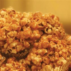 Caramel Popcorn Clusters Recipe - Two favorites--gooey caramel and freshly popped popcorn come together to make this fun treat.