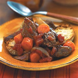 Tuscan Beef Stew Recipe - This slow-simmered beef stew with chunks of carrots, diced tomatoes and cannellini beans captures the rich flavors of Tuscany.