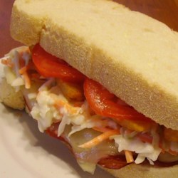 Primanti-Style Sandwiches Recipe - Anyone who has been to Pittsburgh can tell you about the wonderful Primanti Brothers sandwiches which are a local delicacy. Coleslaw, fries, cheese, and meat (or no meat for you veggies) on thickly sliced Italian bread brings a taste of Pittsburgh to wherever you may be. You can substitute your favorite meat for the capicola.