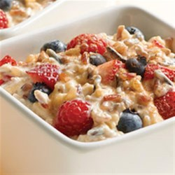 4-Grain Berries and Yogurt Recipe - A medley of hearty whole grains is simmered with fruit juice, then mixed with fresh berries, yogurt, and a touch of cinnamon for a quick and delicious breakfast or snack.