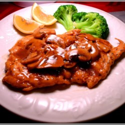 Chicken Marsala Recipe - Herbed chicken in a sweet Marsala and mushroom sauce -- sounds simple, and it is -- simply delicious.