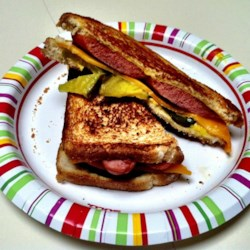 Frankly Super Supper Recipe - Generously buttered sourdough bread slices are layered with a hot dog, sharp Cheddar cheese, and pickles and are pan-fried for a 'frankly' super sandwich.