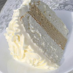 White Almond Wedding Cake Recipe and Video - Start with a white cake mix, and add sour cream and almond flavoring to make a quick, moist cake that's ready for your decorating touches.