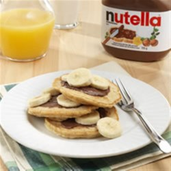 Bananalicious Pancakes with NUTELLA(R) Recipe - A delicious twist on a classic breakfast.