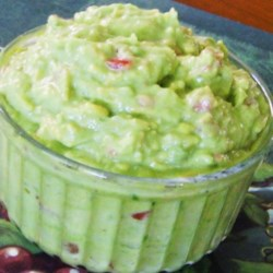 Randy's Amazing Avocado Dip Recipe - Green salsa, sour cream, and avocado combine in a creamy, guacamole-like dip ideal for any occasion.