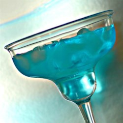 Blue Meanies Recipe - This cocktail recipe is a twist on a traditional margarita, using blue Curacao for added sweetness to everyone's favorite tequila beverage.