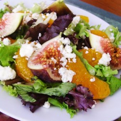 Orange, Fig, and Gorgonzola Salad Recipe - Oranges, figs, and gorgonzola cheese are tossed with romaine lettuce and vinaigrette dressing for a sweet and savory salad.