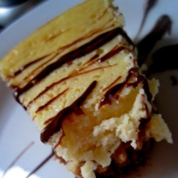 Banana Cheesecake with Caramel Sauce Recipe - Easy and delicious cheesecake. Looks fancy when served drizzled with caramel sauce!