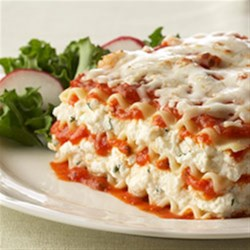Lasagna Formaggio Recipe - Ricotta, mozzarella and Parmesan cheeses seasoned with Italian herbs are layered with pasta and marinara sauce.