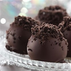 OREO Cookie Balls Recipe - Can't decide between cookies and confections? You don't have to! These chocolate-covered cookie balls feature a filling of cream cheese and crushed cookies.