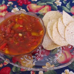 Spicy Salsa Recipe - A fresh, delicious tomato salsa! Feel free to vary the amount of garlic according to what you prefer.
